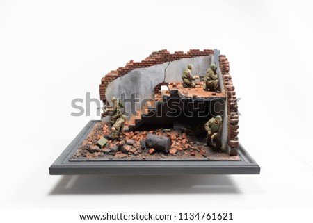 Diorama of storm indoors in ruined building with six soviet soldiers with weapon on white background with copy space