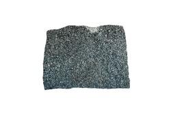 diorite volcanic stone isolated on white background. Coarse-grained intrusive igneous rock.