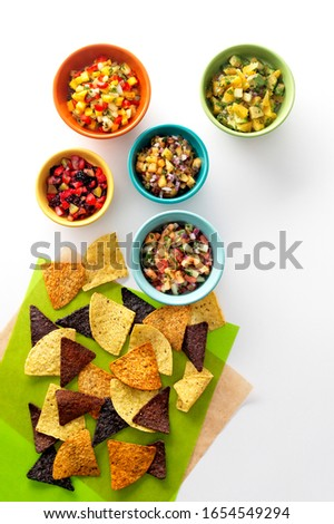 Dip and chips on green napkins on white background