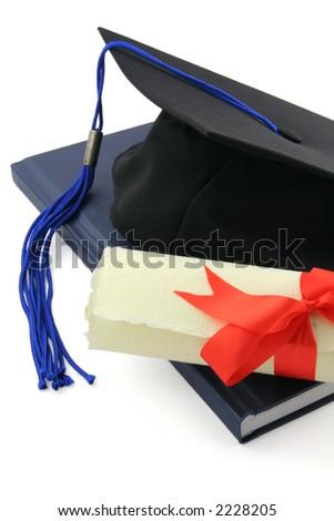 diploma and graduation cap - stock photo