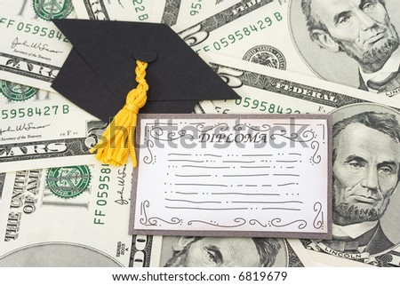 Diploma and graduation cap on American Currency