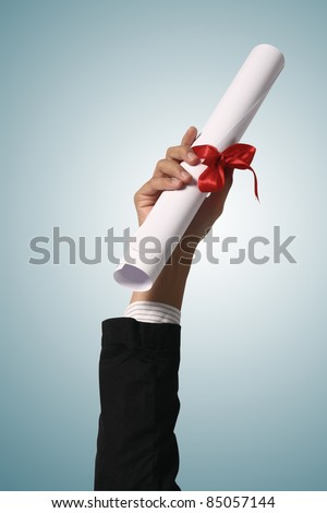 Diploma with a red ribbon in hand  on blue background