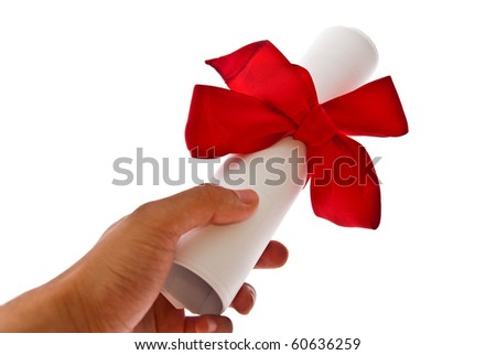 Diploma with a red ribbon in man's hand isolated on a white background