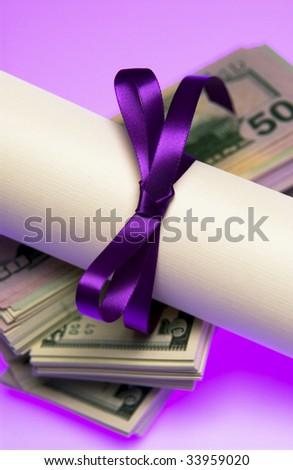Diploma with money - stock photo