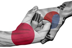 Diplomatic handshake between countries: flags of Japan and South Korea overprinted the two hands