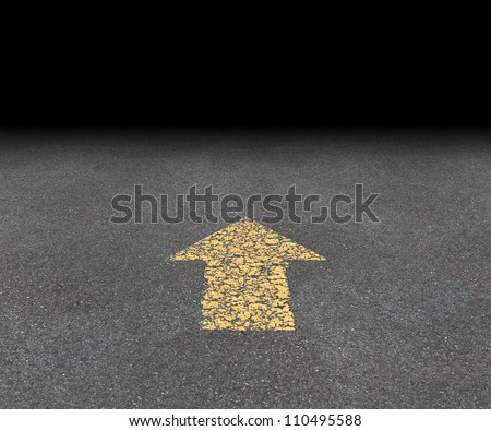 Direction Arrow on an asphalt street with an old fading yellow painted road symbol pointing into the black blank perspective as aspirations and financial success vision of strategy and goals.