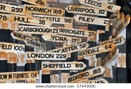 Direction arrows in the UK, with many towns. Eden Camp Museum, Malton - stock photo