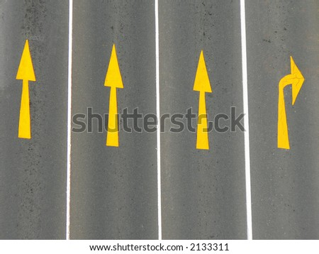 Direction arrows on a road from above.