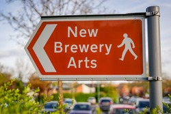 Direction Road Sign to New Brewery Arts, Cirencester