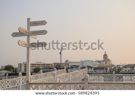 direction sign at the pier #589824395