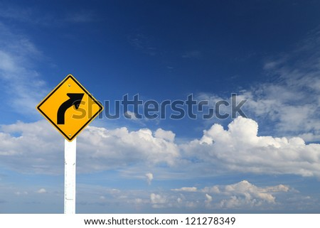 Direction sign- right turn warning on blue sky background with blank for text