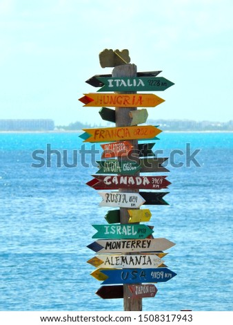 Direction signs and arrows with different destinations and distance #1508317943
