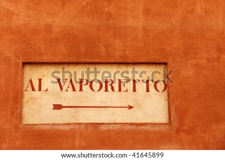 Direction to the vaporetto stop on old Venetian building - stock photo