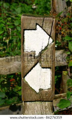 directional arrow sign post - stock photo