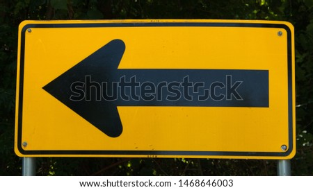 Directional road sign with yellow back ground and black arrows #1468646003