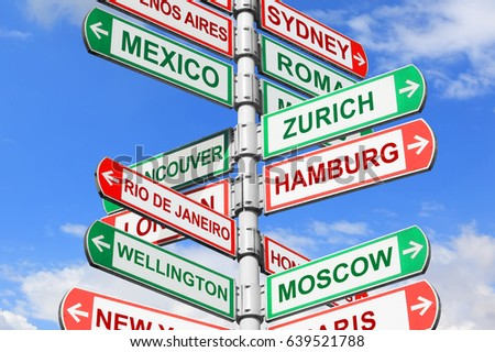 Directional road signs against blue sky. Arrows with a various towns directions on the signpost #639521788