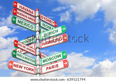 Directional road signs against  blue sky. Arrows with a various towns directions on the signpost #639521794