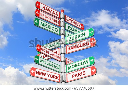 Directional road signs against blue sky. Arrows with a various towns directions on the signpost    #639778597