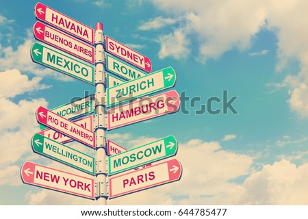 Directional road signs against blue sky. Arrows with a various towns directions on the signpost. Warm toned colors.  Old style image   #644785477