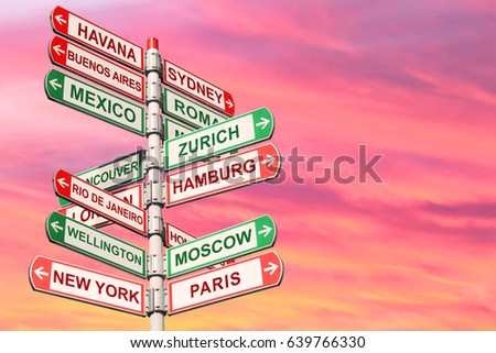 Directional road signs against red sunset sky. Arrows with a various towns directions on the signpost  #639766330