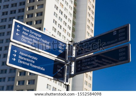 Directional sign indicating the way to various places of interest in Berlin, Germany