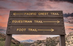 Directional sign pointing towards the Pacific Crest, Equestrian and Foot Trails in Los Angeles County, California.