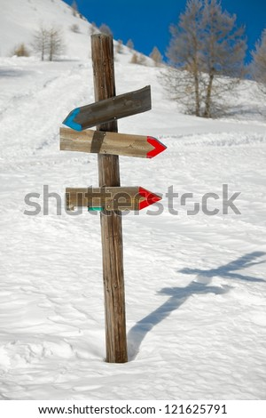 Directional sign post on the snow