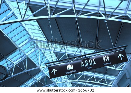 Directional signs inside an airport terminal