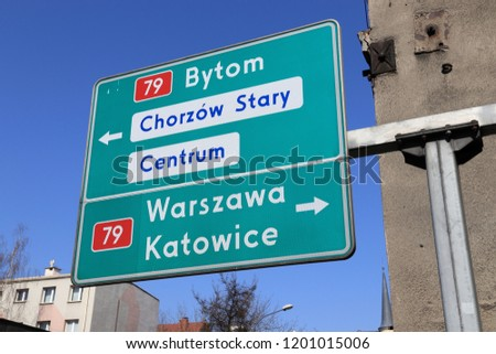 Directions sign in Poland - routes to Warsaw (Warszawa), Katowice and Bytom. #1201015006