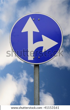 Directions sign on sky background
