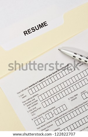 Directly above photograph of a resume and a job application. - stock photo