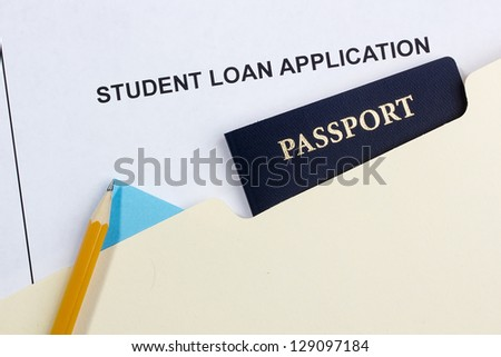 Directly above photograph of a student loan application and a passport.