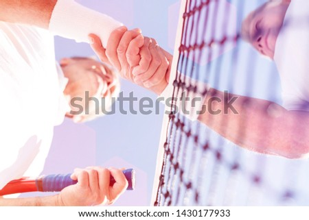 Directly below view of men greeting while standing against clear sky during match on sunny day #1430177933