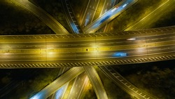 Directly Overhead shot of a freeway junction in the UK at Night