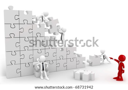 Director and employees working together to put the pieces of a puzzle