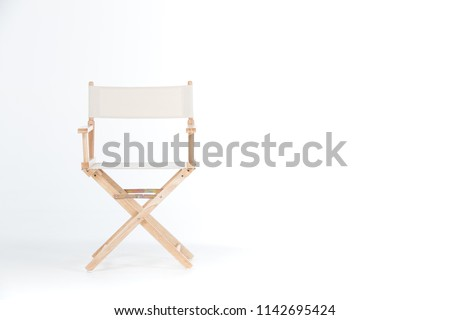 director chair made of wood and fabric well Comfortable sitting on a white backdrop, copy space #1142695424