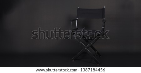 Director chair use in video production , film, cinema industry on black background #1387184456