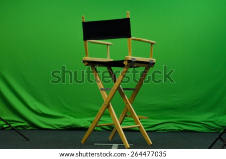 Director\'s chair in front of green screen