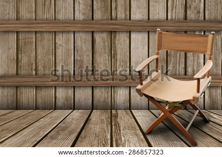 Director\'s chair on the wood background