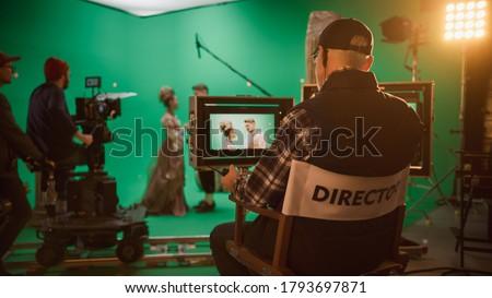 Director Shooting Period Film Green Screen CGI Scene with Actors Wearing Renaissance Costumes. Big Film Studio Professional Crew Shooting Big Budget Movie. Back View Shot Сток-фото ©