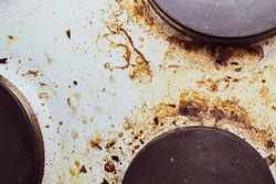 Dirt and grease on the white electric stove