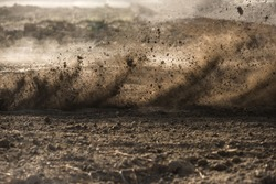 dirt fly after motocross roaring by