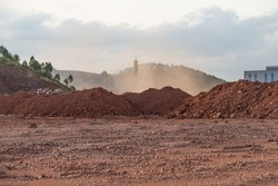 Dirt piles and dust from the wind at the construction site