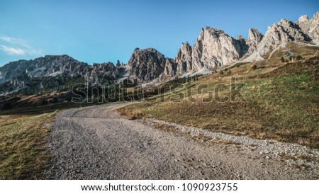 Dirt road and hiking trail track in Dolomites mountain, Italy, in front of Pizes de Cir Ridge mountain ranges in Bolzano, South Tyrol, Northwestern Dolomites, Italy. #1090923755