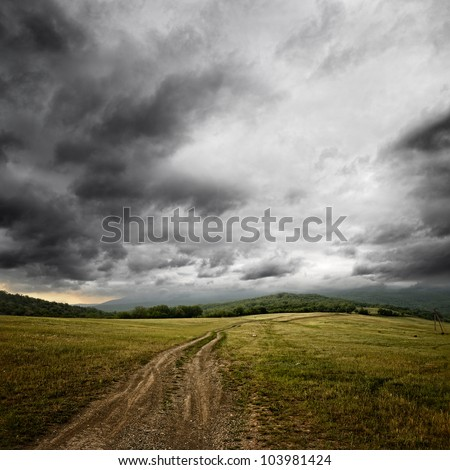 dirt road at the summer dramatic day