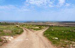 Dirt road fork towards the sea