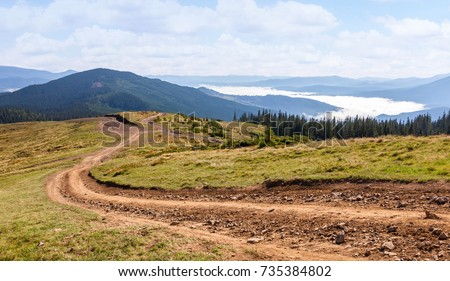 Dirt road in the Carpathian mountains. Ukraine. #735384802