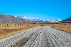 dirt road leading to mountains in Ashburton Lakes District, South Island, New Zealand