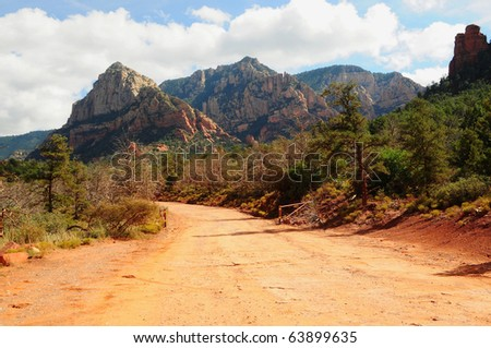 Dirt road leading up into rough mountains