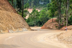 Dirt road,New road surface,Road construction path through the forest.Selective focus.